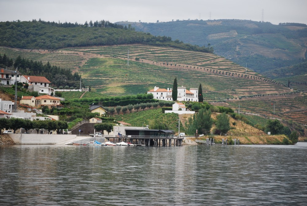 DOC restaurant jutting out over the Douro (from the train, across the river)