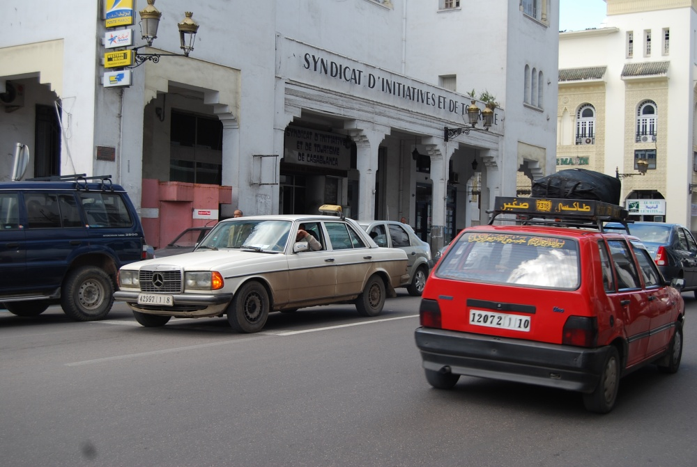 Grand Taxi (white) and Petit Taxi (red) with luggage on top