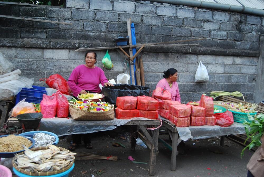 two ladies selling offerings